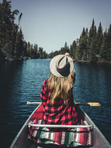 Photo of a Woman Canoeing. Safe Travel Exists at Tallpine!