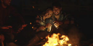 Photo of a Couple By a Campfire, One of the Best Date Ideas.