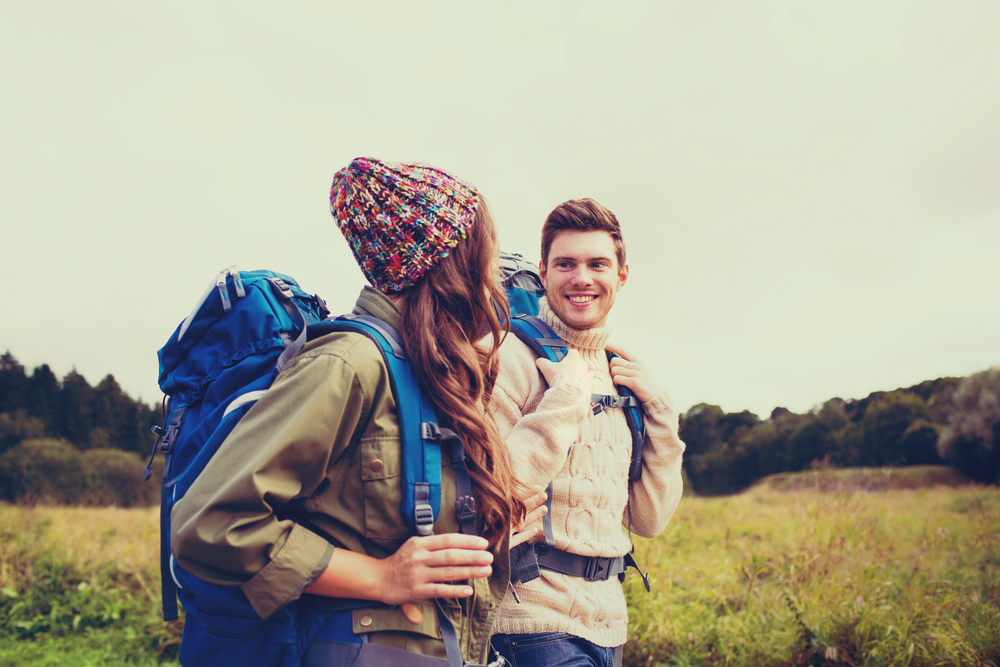 Photo of a Couple Hiking. Safe Travel Exists at Tallpine!