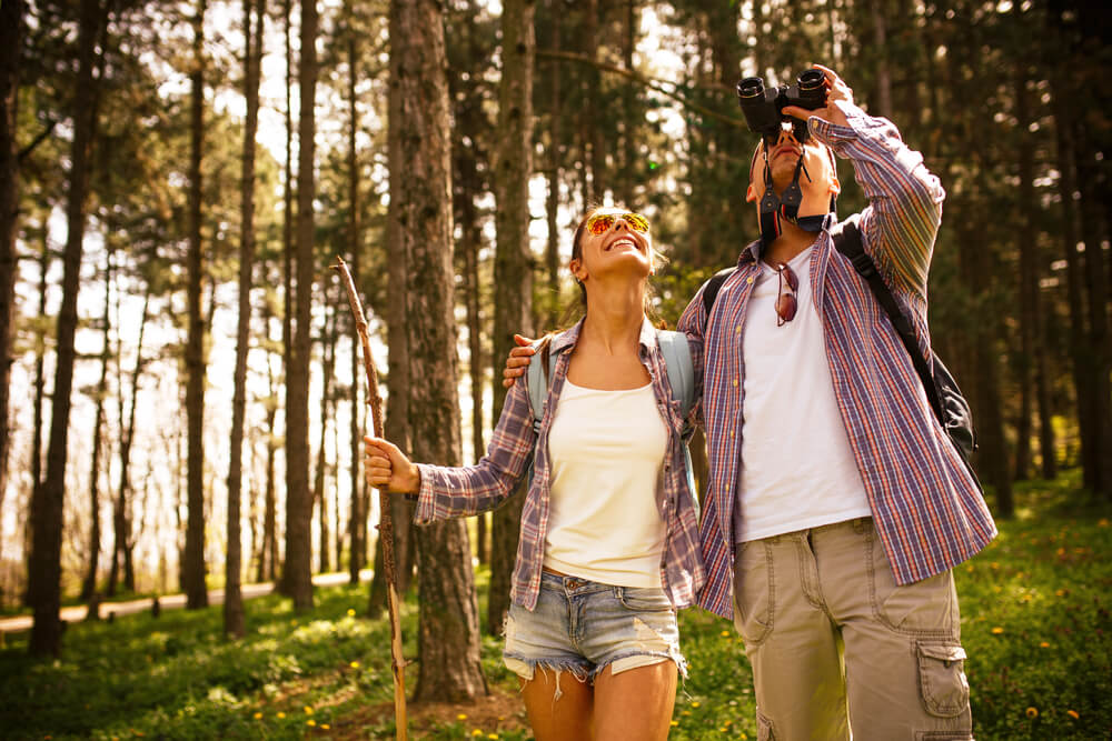 Photo of a Couple Birders Inside Whiteshell Provincial Park.