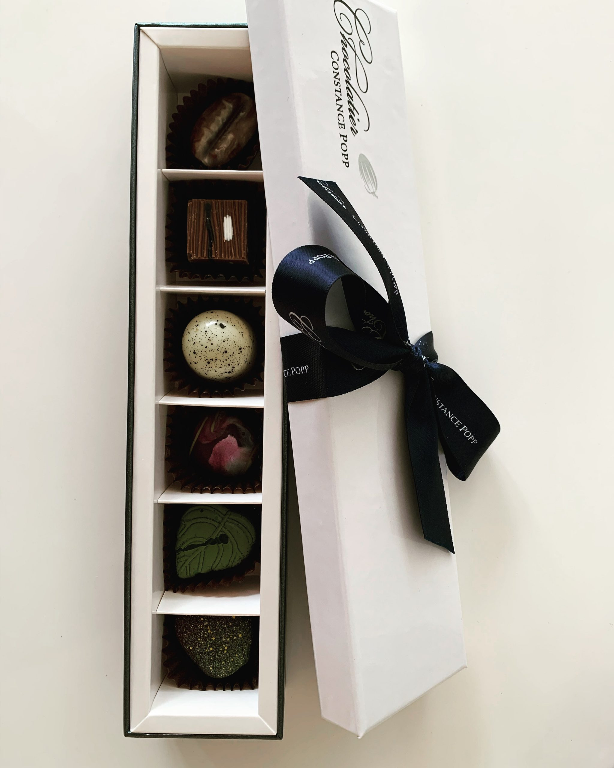 Tallpines Lodge box of chocolates add on package.
