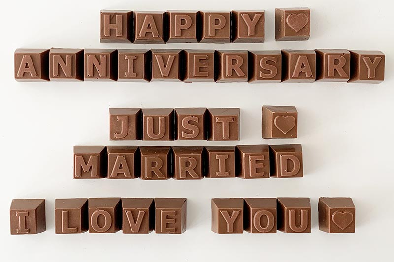 Chocolate letters. Text: Happy Anniversary, Just Married, I Love You.