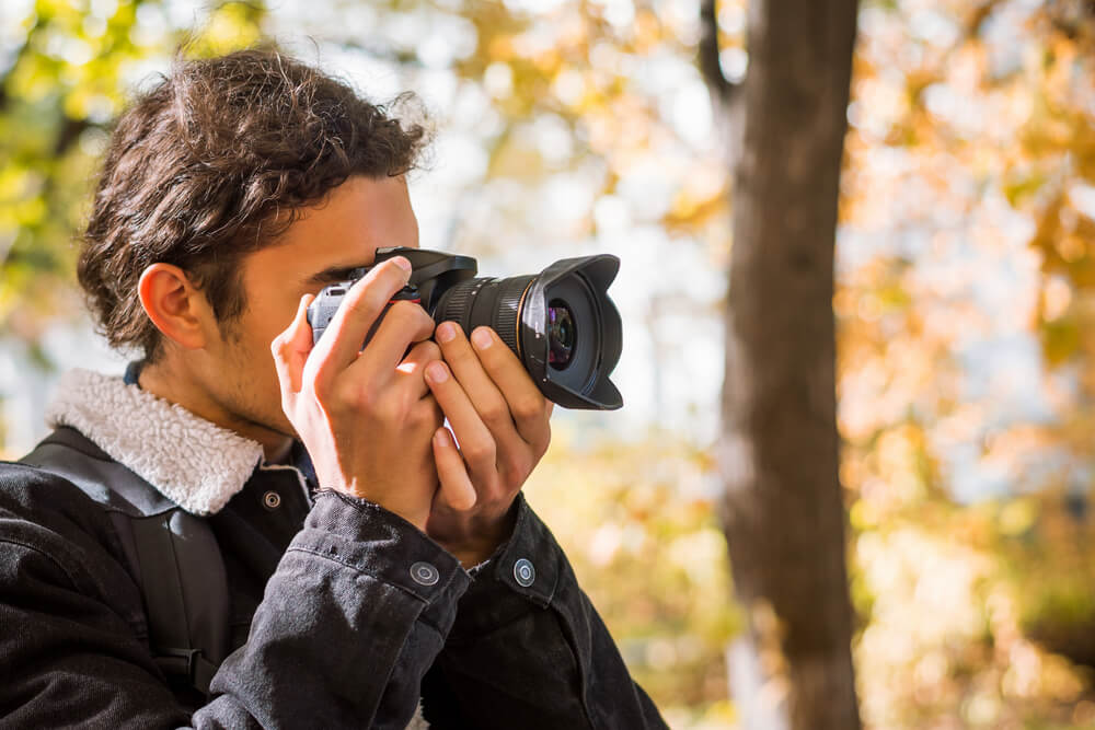 Photo of a Man Snapping a Photo. Fall Photography at Tallpine is a Must!